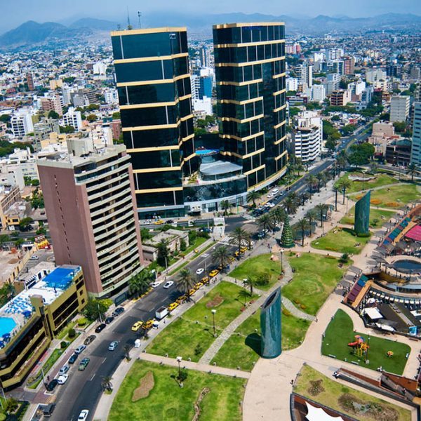 Lima, Perú. Miraflores aerial view: Almost dead center is Marriot Hoet and Casino, right third is Larcomar Shoping Center Complex, down left is Miraflores Casino; up left sights of La Molina Hills, up left Barranco and Chorrillos Hills.